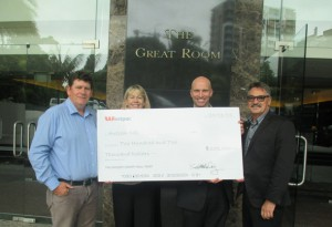 (L to R) Scott McKay, Karen Kelly, Dane Dougan and Don Graham with the cheque for Autism NZ.